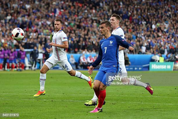 Antoine Griezmann of France scores his side's fourth goal during the UEFA Euro 2016 Quarter Final match between France and Iceland at Stade de France...