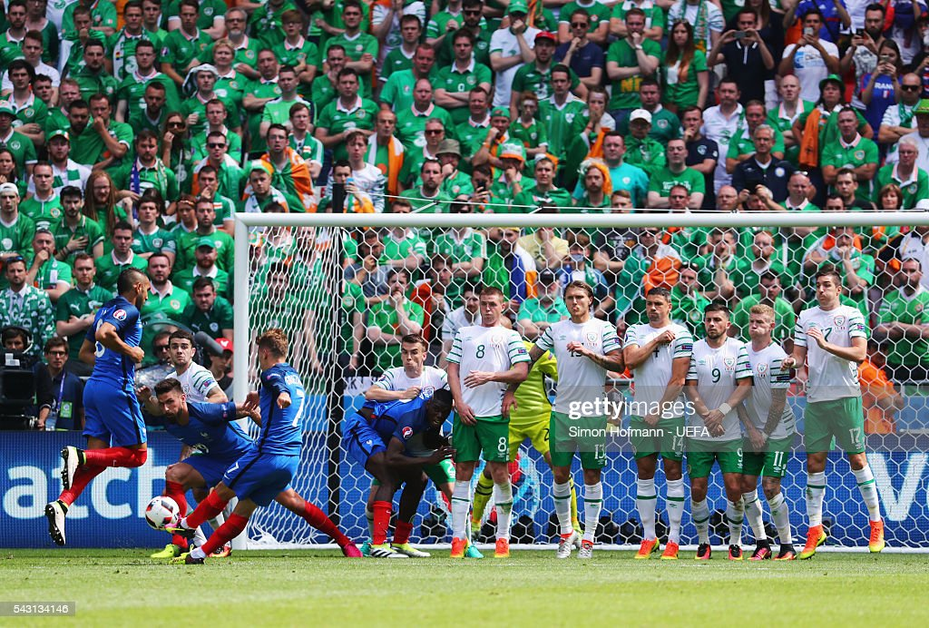 Antoine Griezmann of France takes a free kick during the UEFA EURO 2016 round of 16 match between France and Republic of Ireland at Stade des Lumieres on June 26, 2016 in Lyon, France.