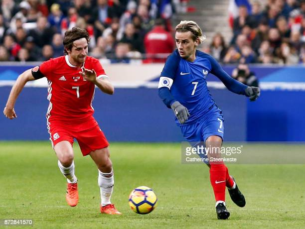 Antoine Griezmann of France tries to control the ball against Joe Allen of Wales during the international friendly match between France and Wales at...