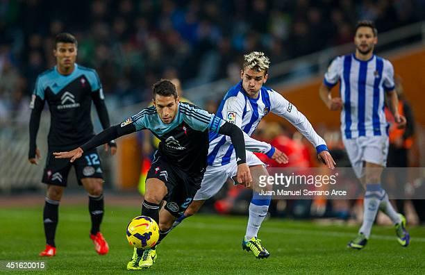 Antoine Griezmann of Real Sociedad competes for the ball with Hugo Mallo of Celta de Vigo during the La Liga match between Real Sociedad de Futbol...
