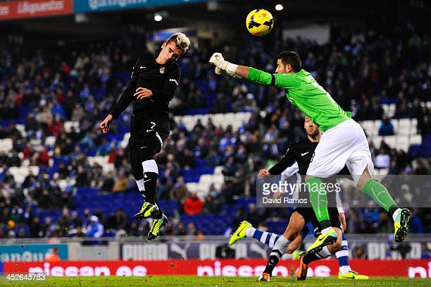 Antoine Griezmann of Real Sociedad scores his team's first goal past Kiko Casilla of RCD Espanyol during the La Liga match between RCD Espanyol and...