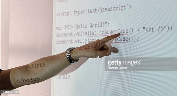 Antoine Hage chief technology officer explains the JavaScript code Technical and nontechnical employees of software company FreeCause attend...