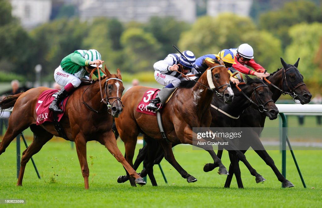 Antoine Hamelin riding Dibajj (L) and William Buick riding Mirza (2L) make it a dead heat to win The Qatar Prix du Petit Couvert at Longchamp racecourse on September 15, 2013 in Paris, France.