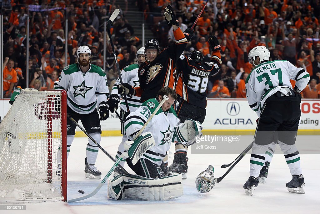 <a gi-track='captionPersonalityLinkClicked' href=/galleries/search?phrase=Antoine+Roussel&family=editorial&specificpeople=4202700 ng-click='$event.stopPropagation()'>Antoine Roussel</a> #21 and goaltender <a gi-track='captionPersonalityLinkClicked' href=/galleries/search?phrase=Kari+Lehtonen&family=editorial&specificpeople=211612 ng-click='$event.stopPropagation()'>Kari Lehtonen</a> #32 of the Dallas Stars look on, as <a gi-track='captionPersonalityLinkClicked' href=/galleries/search?phrase=Corey+Perry&family=editorial&specificpeople=213864 ng-click='$event.stopPropagation()'>Corey Perry</a> #10 and <a gi-track='captionPersonalityLinkClicked' href=/galleries/search?phrase=Matt+Beleskey&family=editorial&specificpeople=570471 ng-click='$event.stopPropagation()'>Matt Beleskey</a> #39 of the Anaheim Ducks celebrate a goal by teammate Ryan Getzlaf (not pictured) in the first period of Game One of the First Round of the 2014 NHL Stanley Cup Playoffs at Honda Center on April 16, 2014 in Anaheim, California.