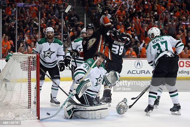 Antoine Roussel and goaltender Kari Lehtonen of the Dallas Stars look on as Corey Perry and Matt Beleskey of the Anaheim Ducks celebrate a goal by...