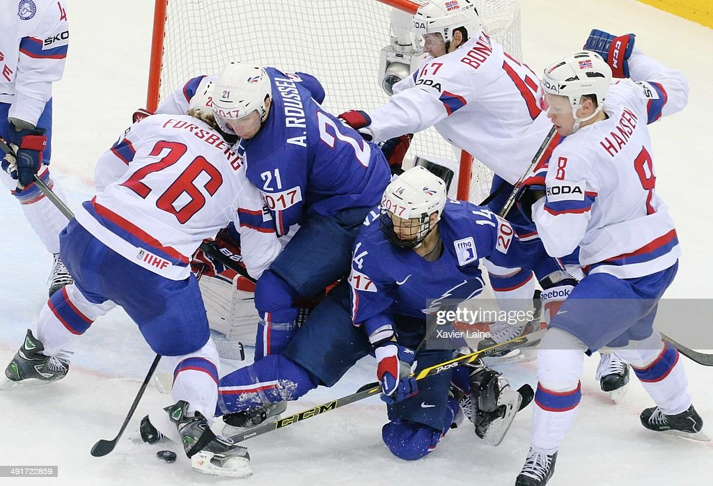 Antoine Roussel and Stephane Da Costa of France battle for the puck with Kristian Forsberg, Alexander Bonsaksen and Mads Hansen of Norway during the 2014 IIHF World Championship between France and Norway at Chizhovka arena ,on may 17,2014 in Minsk, Belarus.