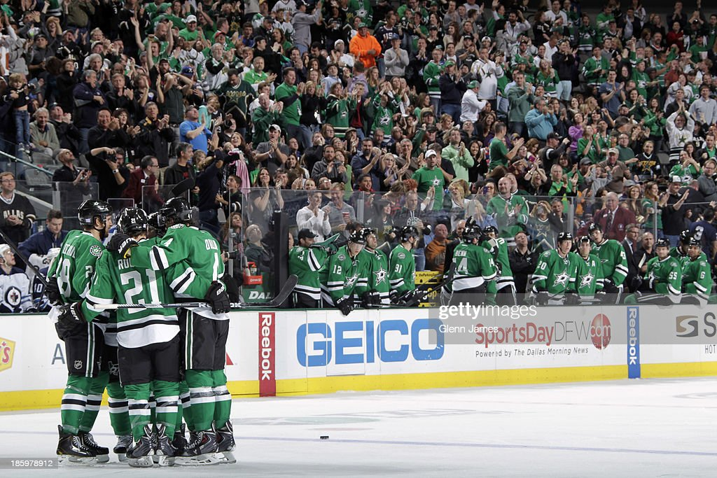 <a gi-track='captionPersonalityLinkClicked' href=/galleries/search?phrase=Antoine+Roussel&family=editorial&specificpeople=4202700 ng-click='$event.stopPropagation()'>Antoine Roussel</a> #21, <a gi-track='captionPersonalityLinkClicked' href=/galleries/search?phrase=Lane+MacDermid&family=editorial&specificpeople=4062198 ng-click='$event.stopPropagation()'>Lane MacDermid</a> #28, <a gi-track='captionPersonalityLinkClicked' href=/galleries/search?phrase=Brenden+Dillon&family=editorial&specificpeople=6254216 ng-click='$event.stopPropagation()'>Brenden Dillon</a> #4 and the Dallas Stars celebrate a goal against the Winnipeg Jets at the American Airlines Center on October 26, 2013 in Dallas, Texas.