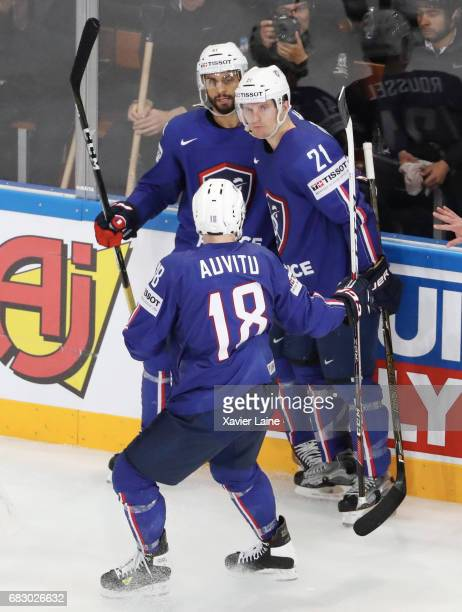 Antoine Roussel of France celebrate his goal with PierreEdouard bellemare and Yohann Auvitu during the 2017 IIHF Ice Hockey World Championship game...