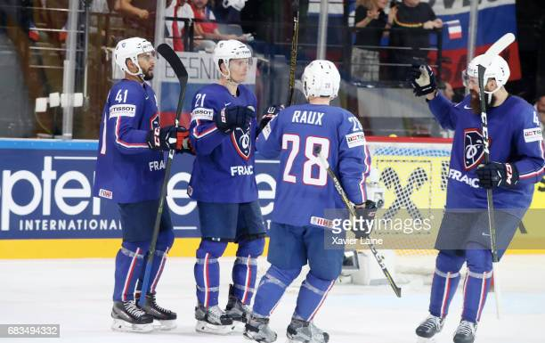 Antoine Roussel of France celebrates his goal with PierreEdouard Bellemare and teammates during the 2017 IIHF Ice Hockey World Championship game...