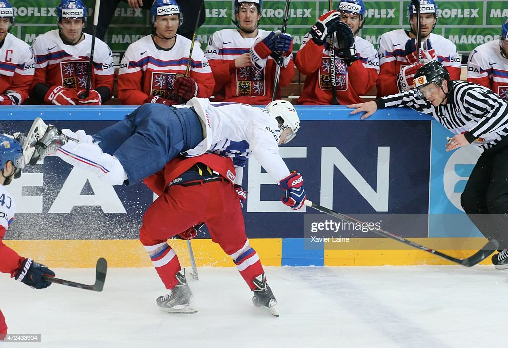 Antoine Roussel #21 of France jump over Ondrej Nemec #23 of Czech Republic during the 2015 IIHF World Championship between Czech Republic and France at O2 arena on May 7, 2015 in Prague, Czech Republic.