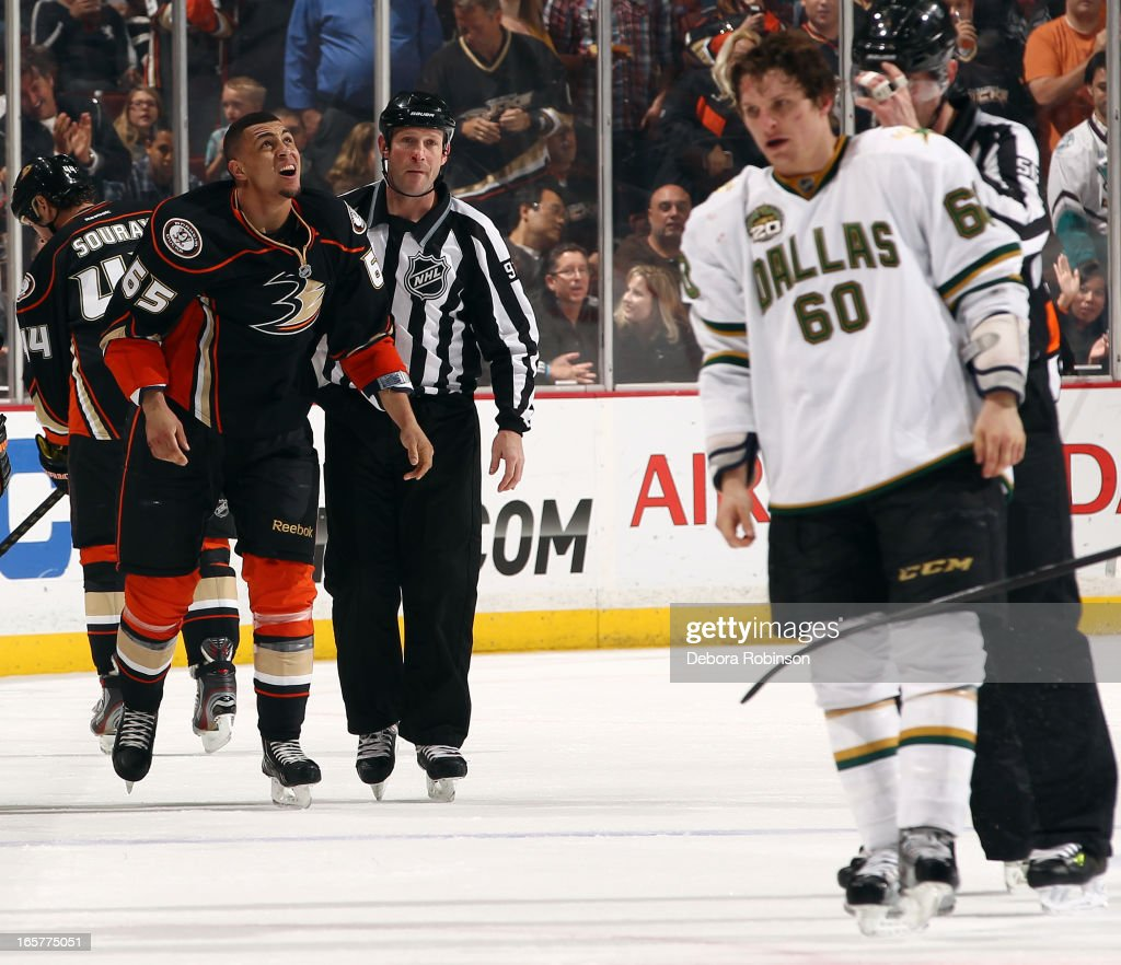<a gi-track='captionPersonalityLinkClicked' href=/galleries/search?phrase=Antoine+Roussel&family=editorial&specificpeople=4202700 ng-click='$event.stopPropagation()'>Antoine Roussel</a> #60 of the Dallas Stars and <a gi-track='captionPersonalityLinkClicked' href=/galleries/search?phrase=Emerson+Etem&family=editorial&specificpeople=6365314 ng-click='$event.stopPropagation()'>Emerson Etem</a> #65 of the Anaheim Ducks are led to their respective penalty boxes after mixing it up during the game on April 5, 2013 at Honda Center in Anaheim, California.