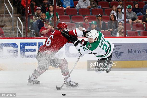 Antoine Roussel of the Dallas Stars attempts a shot past Michael Stone of the Arizona Coyotes during the third period of the NHL game at Gila River...