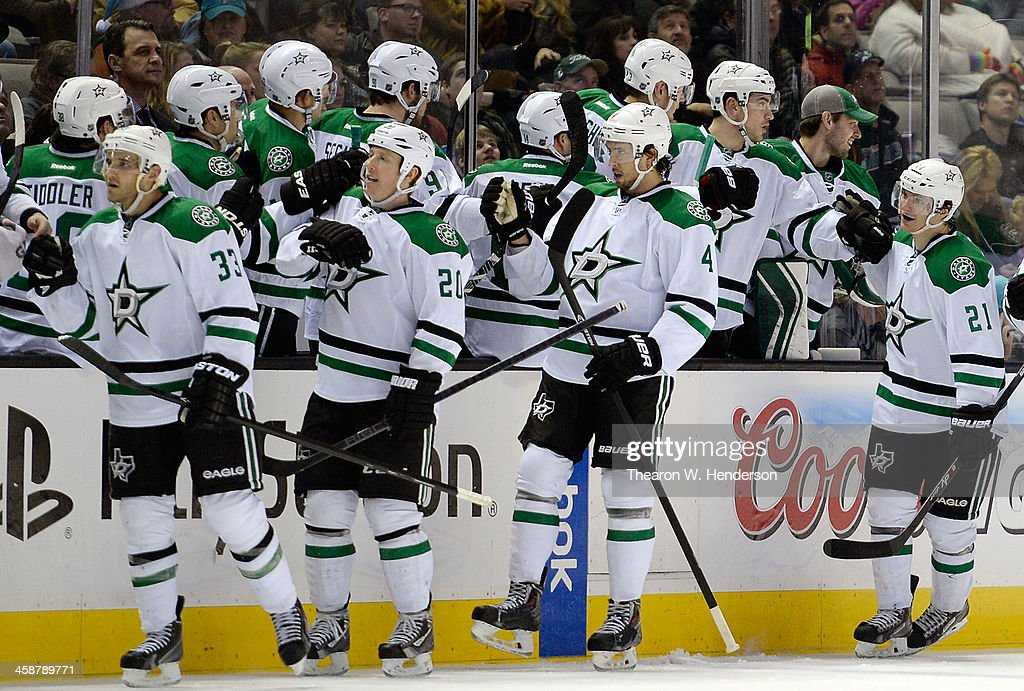 <a gi-track='captionPersonalityLinkClicked' href=/galleries/search?phrase=Antoine+Roussel&family=editorial&specificpeople=4202700 ng-click='$event.stopPropagation()'>Antoine Roussel</a> #21 of the Dallas Stars celebrates with teammates after he scored a goal against the San Jose Sharks during the second period at SAP Center on December 21, 2013 in San Jose, California.