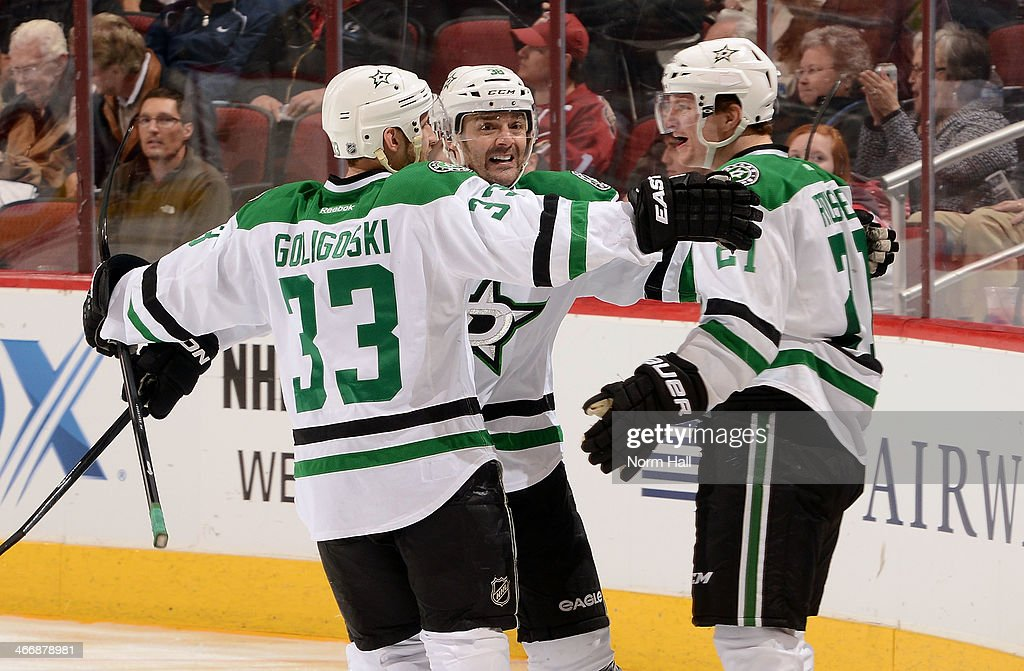 Antoine Roussel #21 of the Dallas Stars celebrates with teammates Alex Goligoski #33 and Vernon Fiddler #38 after his third period goal against the Phoenix Coyotes at Jobing.com Arena on February 4, 2014 in Glendale, Arizona.