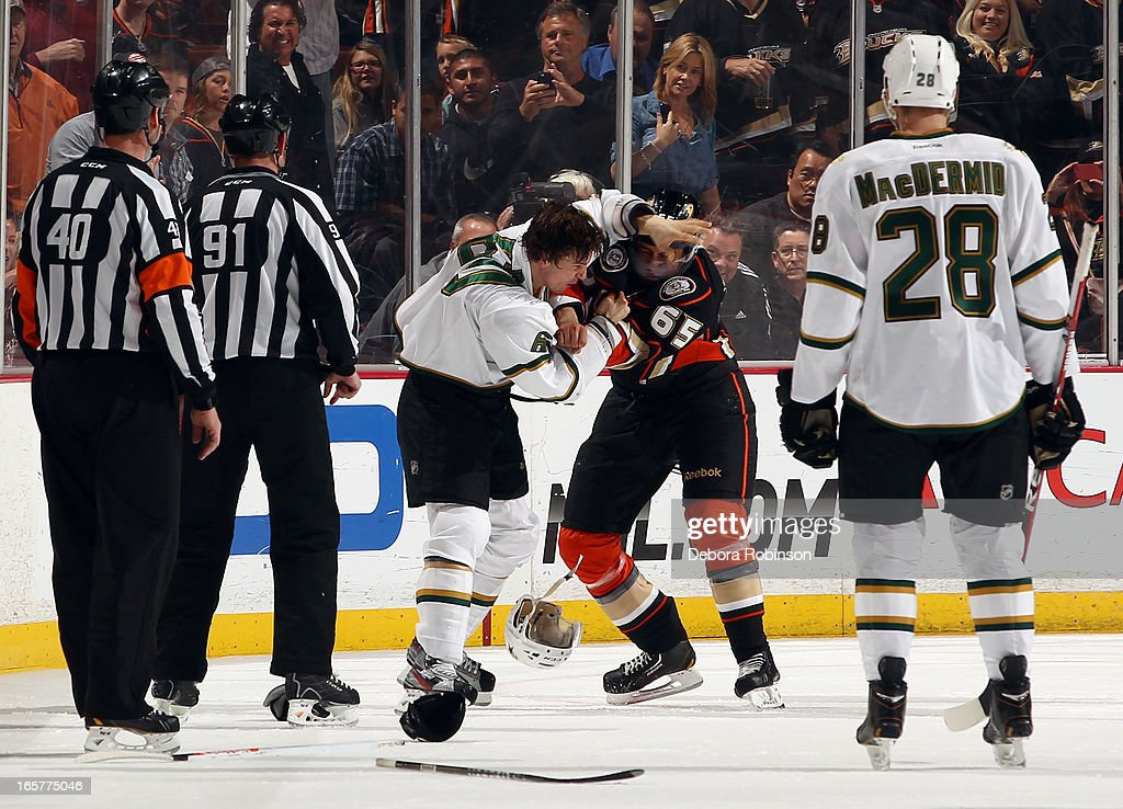 <a gi-track='captionPersonalityLinkClicked' href=/galleries/search?phrase=Antoine+Roussel&family=editorial&specificpeople=4202700 ng-click='$event.stopPropagation()'>Antoine Roussel</a> #60 of the Dallas Stars mixes it up with <a gi-track='captionPersonalityLinkClicked' href=/galleries/search?phrase=Emerson+Etem&family=editorial&specificpeople=6365314 ng-click='$event.stopPropagation()'>Emerson Etem</a> #65 of the Anaheim Ducks on April 5, 2013 at Honda Center in Anaheim, California.