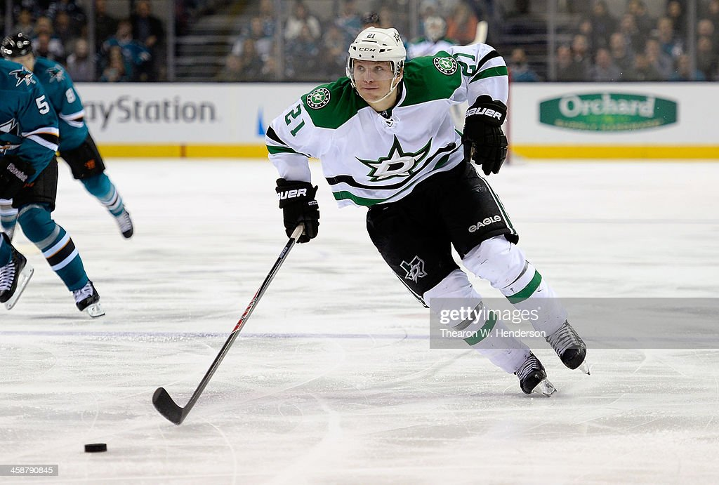Antoine Roussel #21 of the Dallas Stars skates up ice with control of the puck against the San Jose Sharks during the third period at SAP Center on December 21, 2013 in San Jose, California. The Sharks won the game in an overtime shoot-out 3-2.