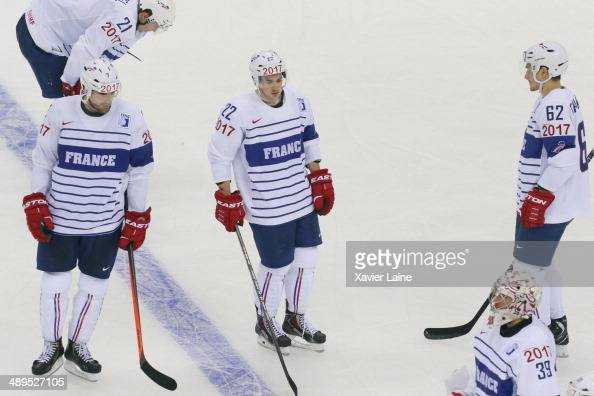 Antoine Roussel Yorick Treille Brian Henderson Florian Chakiachvili and Cristobal Huet of France react after defeat during the 2014 IIHF World...
