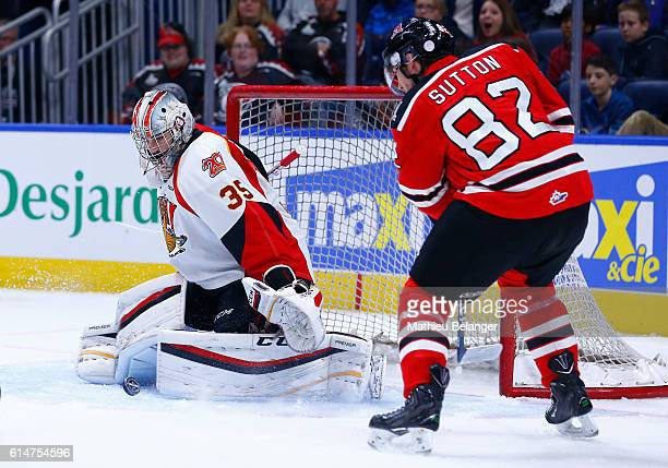Antoine Samuel of the Baie Comeau Drakkar makes a save on Jesse Sutton of the Quebec Remparts during their QMJHL hockey game at the Centre Videotron...