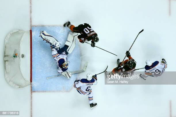 Antoine Vermette and Jakob Silfverberg of the Anaheim Ducks skate in front of the goal as Cam Talbot Leon Draisaitl and Adam Larsson of the Edmonton...