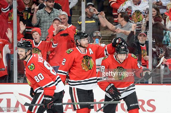Antoine Vermette Duncan Keith and Patrick Kane of the Chicago Blackhawks celebrate after Kane scored against the Minnesota Wild in the third period...