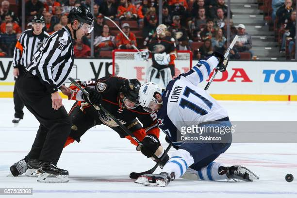 Antoine Vermette of the Anaheim Ducks battles in a faceoff against Adam Lowry of the Winnipeg Jets during the game on March 24 2017 at Honda Center...