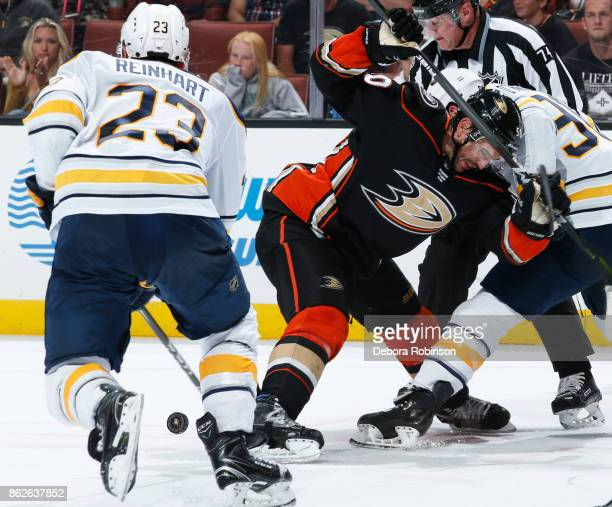 Antoine Vermette of the Anaheim Ducks battles in a faceoff against Ryan O'Reilly and Sam Reinhart of the Buffalo Sabres during the game on October 15...