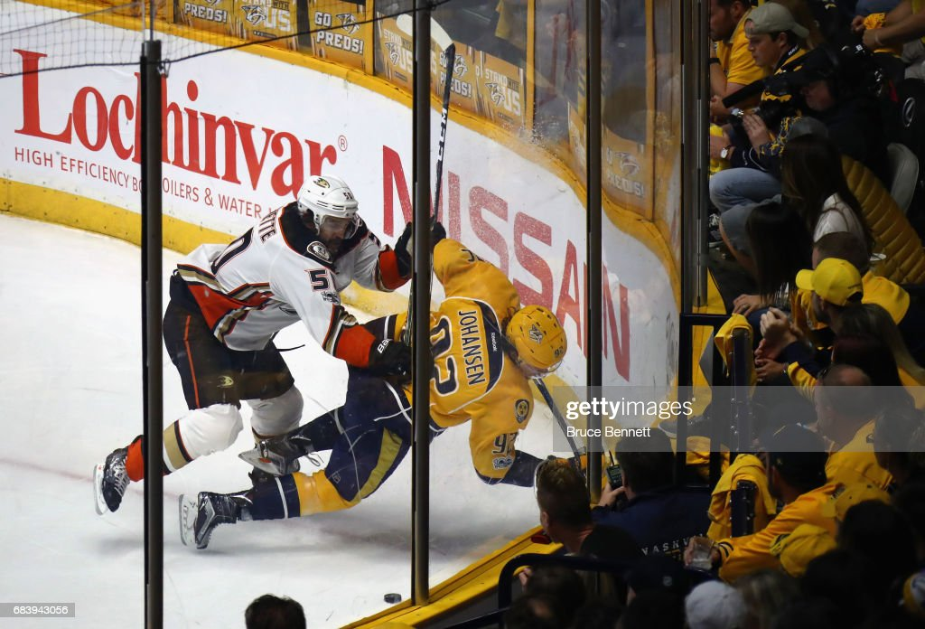 Antoine Vermette #50 of the Anaheim Ducks checks Ryan Johansen #92 of the Nashville Predators during the first period in Game Three of the Western Conference Final during the 2017 Stanley Cup Playoffs at Bridgestone Arena on May 16, 2017 in Nashville, Tennessee.