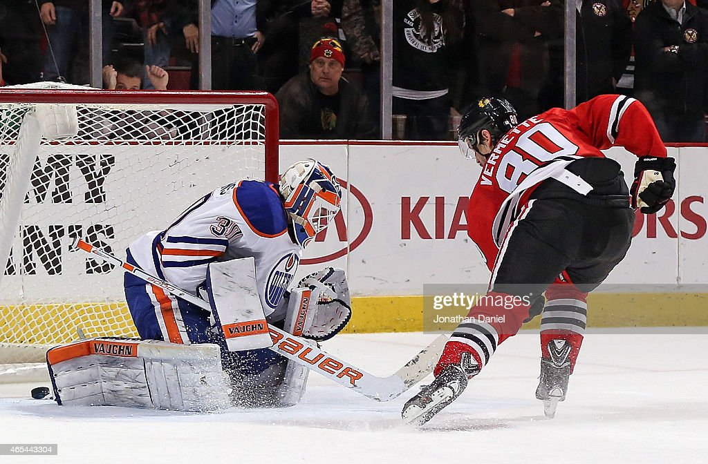 <a gi-track='captionPersonalityLinkClicked' href=/galleries/search?phrase=Antoine+Vermette&family=editorial&specificpeople=206302 ng-click='$event.stopPropagation()'>Antoine Vermette</a> #80 of the Chicago Blackhawks scores the game-winning goal in the shootout against <a gi-track='captionPersonalityLinkClicked' href=/galleries/search?phrase=Ben+Scrivens&family=editorial&specificpeople=7185205 ng-click='$event.stopPropagation()'>Ben Scrivens</a> #30 of the Edmonton Oilers at the United Center on March 6, 2015 in Chicago, Illinois. The Blackhawks defeated the Oilers 2-1 in a shootout.
