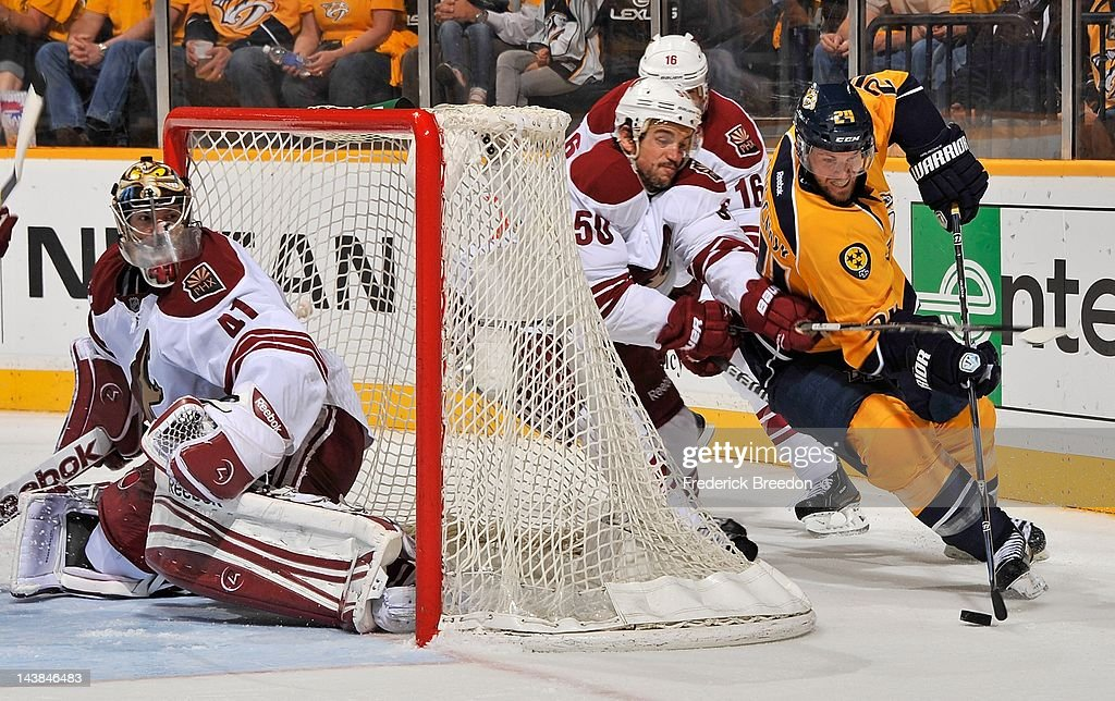 Antoine Vermette of the Phoenix Coyotes and Matt Halischuk fight for the puck behind goalie Mike Smith in Game Four of the Western Conference...