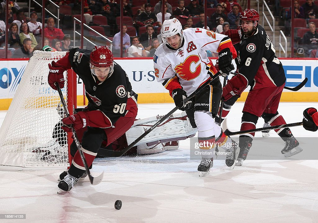 <a gi-track='captionPersonalityLinkClicked' href=/galleries/search?phrase=Antoine+Vermette&family=editorial&specificpeople=206302 ng-click='$event.stopPropagation()'>Antoine Vermette</a> #50 of the Phoenix Coyotes attempts to clear the puck from <a gi-track='captionPersonalityLinkClicked' href=/galleries/search?phrase=Lee+Stempniak&family=editorial&specificpeople=575240 ng-click='$event.stopPropagation()'>Lee Stempniak</a> #22 of the Calgary Flames during the third period of the NHL game at Jobing.com Arena on October 22, 2013 in Glendale, Arizona. The Coyotes defeated the Flames 4-2.