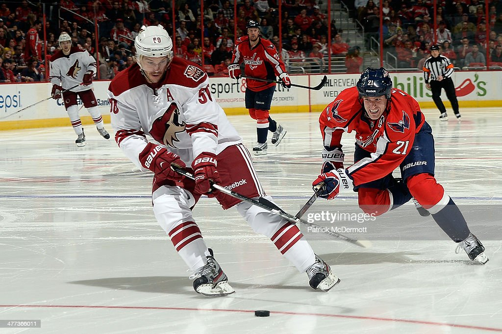 <a gi-track='captionPersonalityLinkClicked' href=/galleries/search?phrase=Antoine+Vermette&family=editorial&specificpeople=206302 ng-click='$event.stopPropagation()'>Antoine Vermette</a> #50 of the Phoenix Coyotes battles for the puck against <a gi-track='captionPersonalityLinkClicked' href=/galleries/search?phrase=Brooks+Laich&family=editorial&specificpeople=554432 ng-click='$event.stopPropagation()'>Brooks Laich</a> #21 of the Washington Capitals in the third period during an NHL game at Verizon Center on March 8, 2014 in Washington, DC.