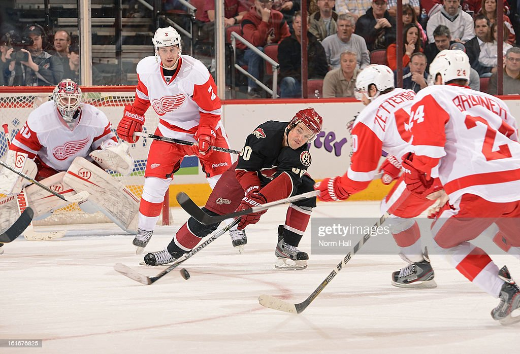 <a gi-track='captionPersonalityLinkClicked' href=/galleries/search?phrase=Antoine+Vermette&family=editorial&specificpeople=206302 ng-click='$event.stopPropagation()'>Antoine Vermette</a> #50 of the Phoenix Coyotes battles for the puck with <a gi-track='captionPersonalityLinkClicked' href=/galleries/search?phrase=Henrik+Zetterberg&family=editorial&specificpeople=201520 ng-click='$event.stopPropagation()'>Henrik Zetterberg</a> #40 of the Detroit Red Wings during the third period at Jobing.com Arena on March 25, 2013 in Glendale, Arizona.