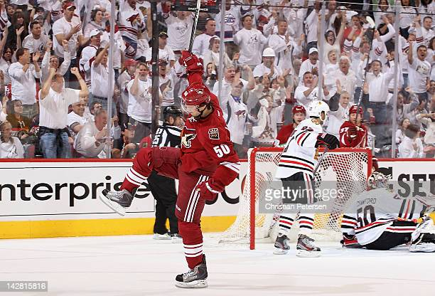 Antoine Vermette of the Phoenix Coyotes celebrates after scoring a second period goal past goaltender Corey Crawford of the Chicago Blackhawks in...