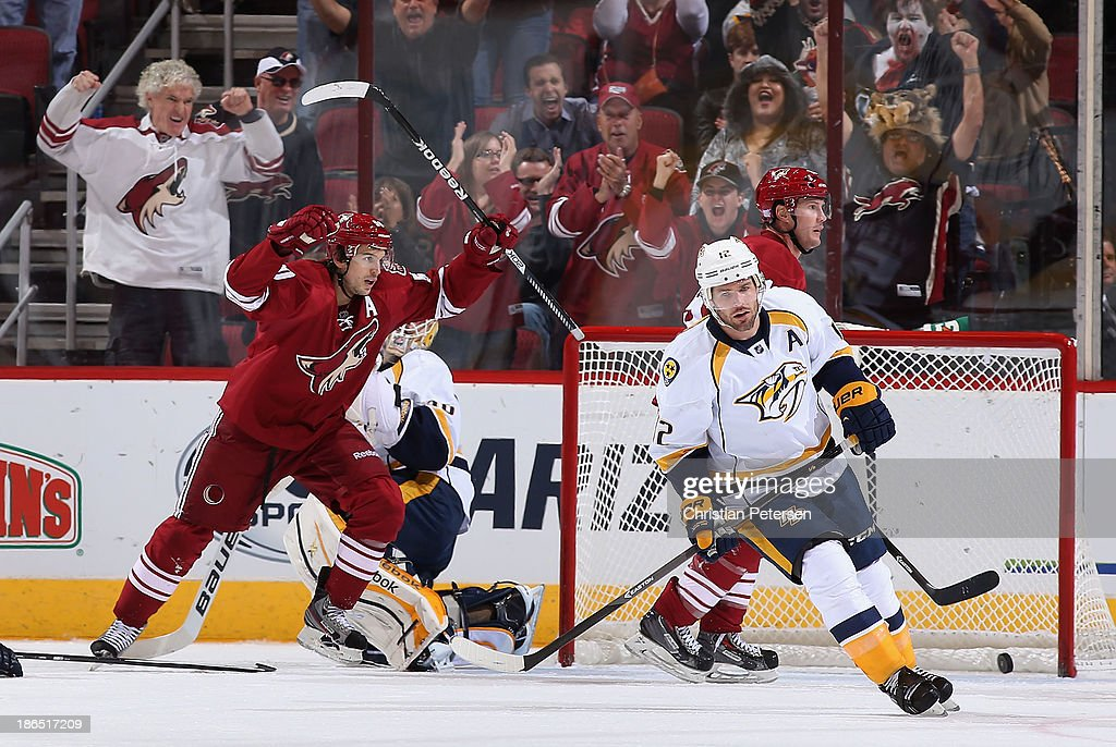 <a gi-track='captionPersonalityLinkClicked' href=/galleries/search?phrase=Antoine+Vermette&family=editorial&specificpeople=206302 ng-click='$event.stopPropagation()'>Antoine Vermette</a> #50 of the Phoenix Coyotes celebrates with <a gi-track='captionPersonalityLinkClicked' href=/galleries/search?phrase=Shane+Doan&family=editorial&specificpeople=201614 ng-click='$event.stopPropagation()'>Shane Doan</a> #19 after Doan scored a third period goal against goaltender Carter Hutton #30 of the Nashville Predators during the NHL game at Jobing.com Arena on October 31, 2013 in Glendale, Arizona. The Coyotes defeated the Predators 5-4 in an overtime shoot out.