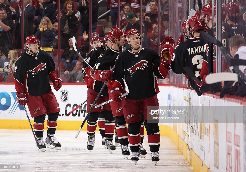 Antoine Vermette #50 of the Phoenix Coyotes celebrates with teammates on the bench after scoring a second period goal against the Anaheim Ducks during the NHL game at Jobing.com Arena on March 4, 2013 in Glendale, Arizona.