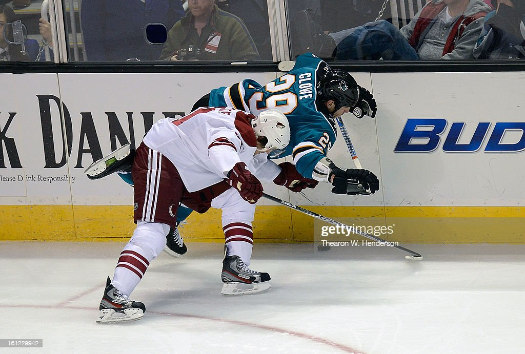 <a gi-track='captionPersonalityLinkClicked' href=/galleries/search?phrase=Antoine+Vermette&family=editorial&specificpeople=206302 ng-click='$event.stopPropagation()'>Antoine Vermette</a> #50 of the Phoenix Coyotes collides with <a gi-track='captionPersonalityLinkClicked' href=/galleries/search?phrase=Ryane+Clowe&family=editorial&specificpeople=736658 ng-click='$event.stopPropagation()'>Ryane Clowe</a> #29 of the San Jose Sharks in the third period at HP Pavilion on February 9, 2013 in San Jose, California. The Coyotes won the game 1-0 in an overtime shoot-out.