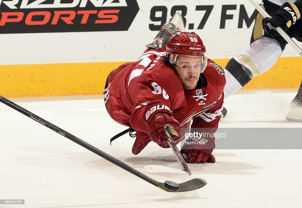 <a gi-track='captionPersonalityLinkClicked' href=/galleries/search?phrase=Antoine+Vermette&family=editorial&specificpeople=206302 ng-click='$event.stopPropagation()'>Antoine Vermette</a> #50 of the Phoenix Coyotes dives for the puck against the Pittsburgh Penguins at Jobing.com Arena on February 1, 2014 in Glendale, Arizona.
