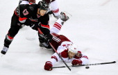 Antoine Vermette of the Phoenix Coyotes dives to knock the puck away from Jeff Skinner of the Carolina Hurricanes during play at PNC Arena on October...