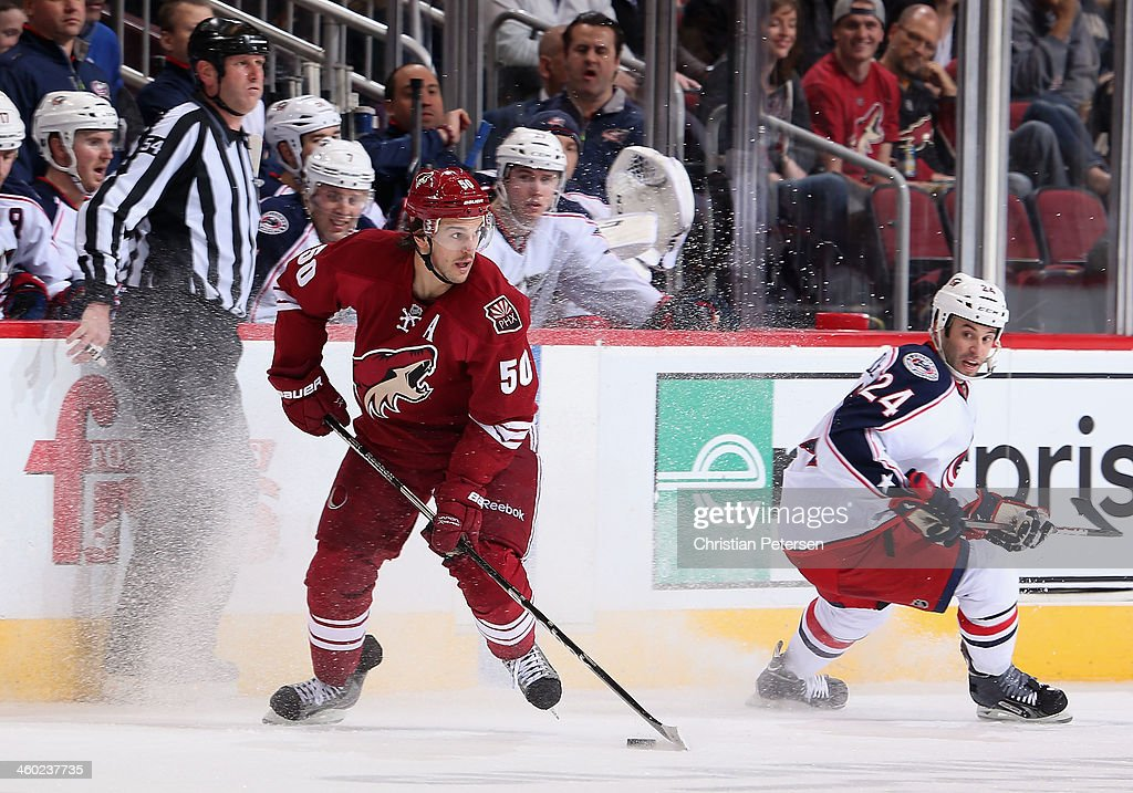 <a gi-track='captionPersonalityLinkClicked' href=/galleries/search?phrase=Antoine+Vermette&family=editorial&specificpeople=206302 ng-click='$event.stopPropagation()'>Antoine Vermette</a> #50 of the Phoenix Coyotes handles the puck ahead of <a gi-track='captionPersonalityLinkClicked' href=/galleries/search?phrase=Derek+MacKenzie&family=editorial&specificpeople=685877 ng-click='$event.stopPropagation()'>Derek MacKenzie</a> #24 of the Columbus Blue Jackets during the third period of the NHL game at Jobing.com Arena on January 2, 2014 in Glendale, Arizona. The Blue Jackets defeated the Coyotes 2-0.