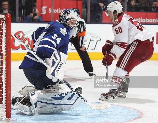 Antoine Vermette of the Phoenix Coyotes is stopped on the final attempt in the shootout by James Reimer of the Toronto Maple Leafs during an NHL game...