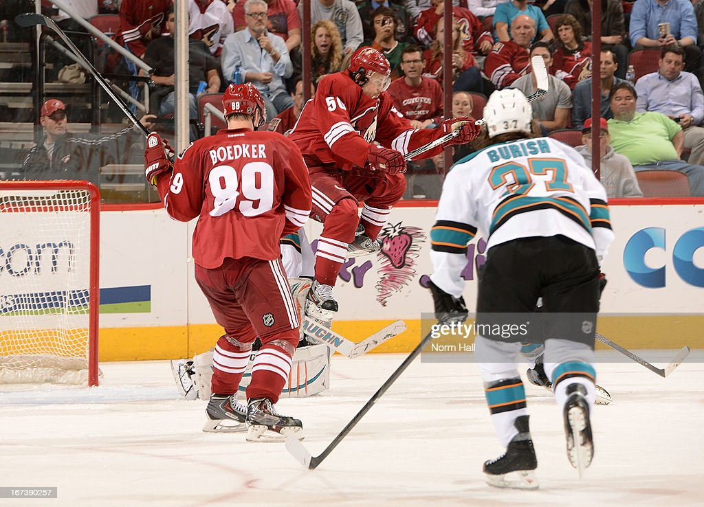 <a gi-track='captionPersonalityLinkClicked' href=/galleries/search?phrase=Antoine+Vermette&family=editorial&specificpeople=206302 ng-click='$event.stopPropagation()'>Antoine Vermette</a> #50 of the Phoenix Coyotes leaps to re-direct a puck in front of goaltender <a gi-track='captionPersonalityLinkClicked' href=/galleries/search?phrase=Thomas+Greiss&family=editorial&specificpeople=695275 ng-click='$event.stopPropagation()'>Thomas Greiss</a> #1 of the San Jose Sharks during the third period at Jobing.com Arena on April 24, 2013 in Glendale, Arizona.