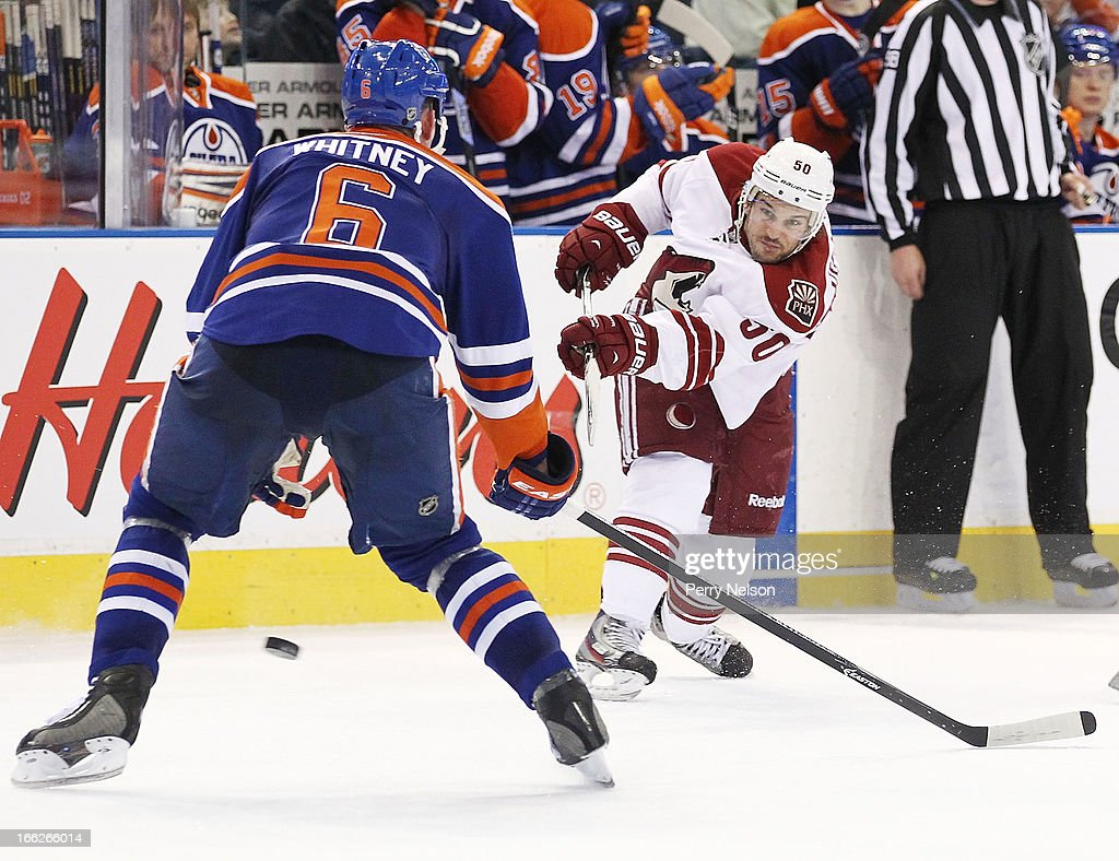 <a gi-track='captionPersonalityLinkClicked' href=/galleries/search?phrase=Antoine+Vermette&family=editorial&specificpeople=206302 ng-click='$event.stopPropagation()'>Antoine Vermette</a> #50 of the Phoenix Coyotes lets a shot go while <a gi-track='captionPersonalityLinkClicked' href=/galleries/search?phrase=Ryan+Whitney&family=editorial&specificpeople=584338 ng-click='$event.stopPropagation()'>Ryan Whitney</a> #6 of the Edmonton Oilers tries to block it at Rexall Place on April 10, 2013 in Edmonton, Canada.