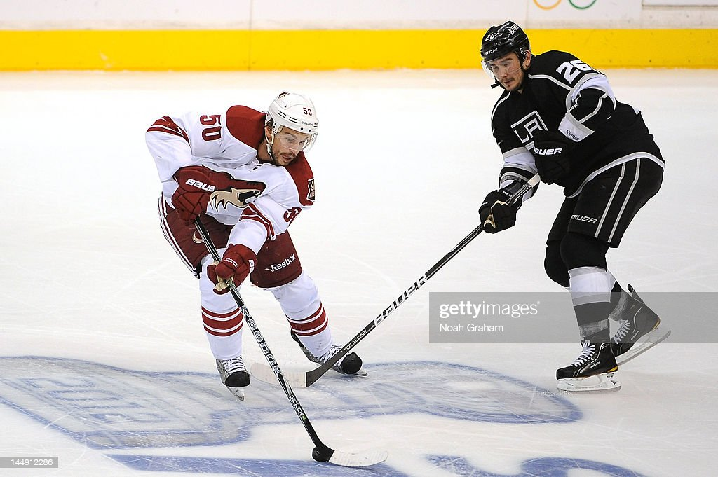 <a gi-track='captionPersonalityLinkClicked' href=/galleries/search?phrase=Antoine+Vermette&family=editorial&specificpeople=206302 ng-click='$event.stopPropagation()'>Antoine Vermette</a> #50 of the Phoenix Coyotes skates with the puck against Slava Voynov #26 of the Los Angeles Kings in Game Four of the Western Conference Finals during the 2012 NHL Stanley Cup Playoffs at Staples Center on May 20, 2012 in Los Angeles, California.