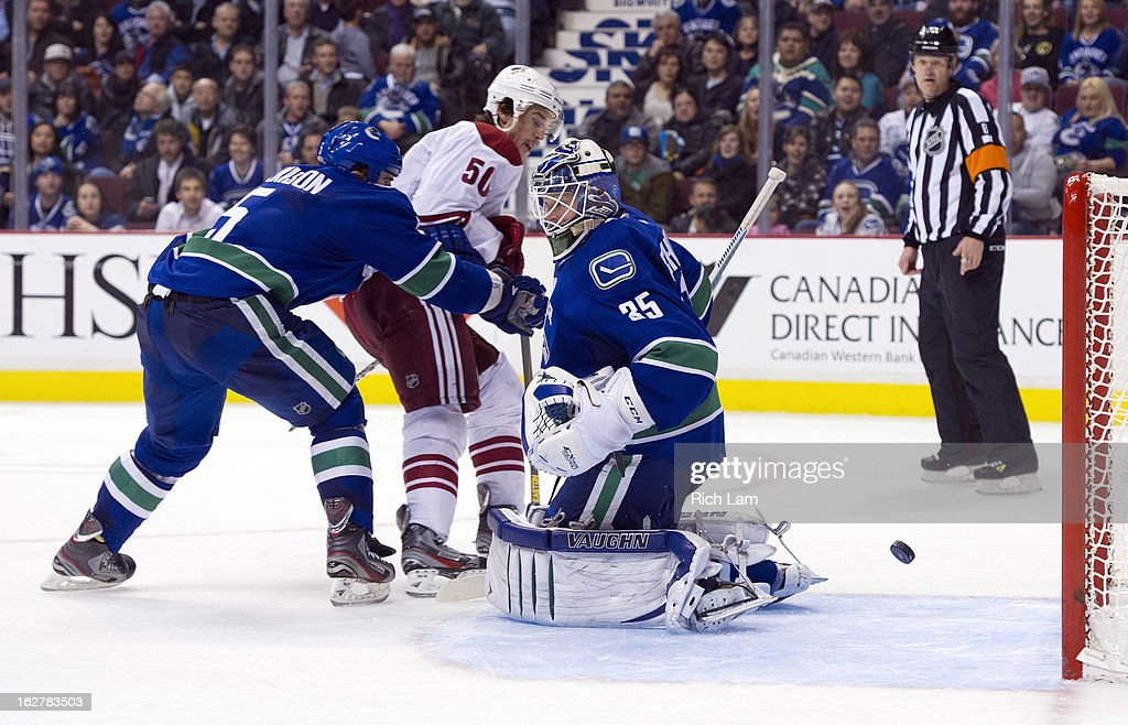 Antoine Vermette #50 of the Phoenix Coyotes watches the puck slip past goalie Cory Schneider #35 of the Vancouver Canucks for a goal during the third period in NHL action on February 26, 2013 at Rogers Arena in Vancouver, British Columbia, Canada. Jason Garrison #5 of the Vancouver Canucks helps defend on the play