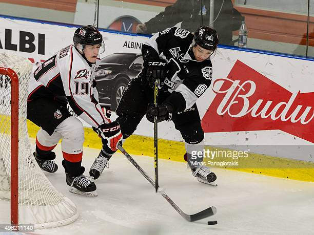 Antoine Waked of the Huskies de RouynNoranda and Charlie Roy of the BlainvilleBoisbriand Armada battle for the puck behind the net during the QMJHL...