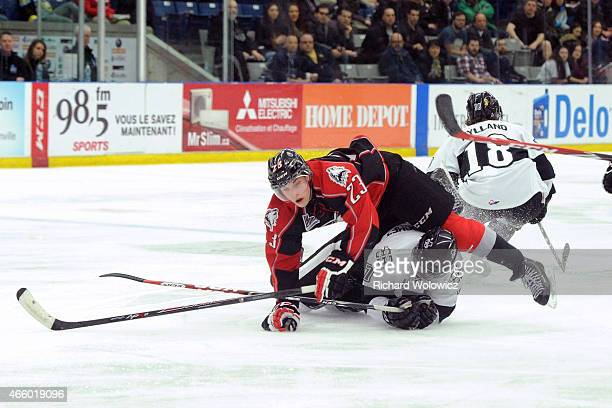 Antoine Waked of the RouynNoranda Huskies collides with Olivier SchinghGomez of the BlainvilleBoisbriand Armada during the QMJHL game at the Centre...