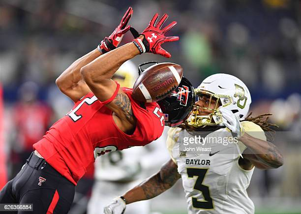 Antoine Wesley of the Texas Tech Red Raiders cannot make the catch while defended by Tion Wright of the Baylor Bears during the game on November 25...