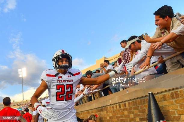 Antoine Wesley of the Texas Tech Red Raiders interacts with fans before the game between the Texas Tech Red Raiders and the Arizona State Sun Devils...