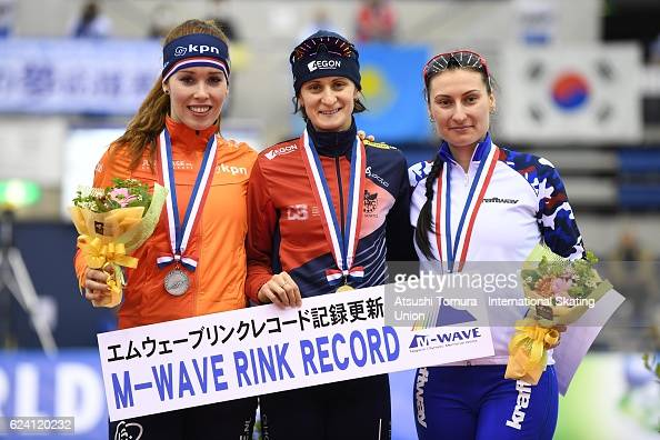 Antoinette de Jong of Netherla Martina Sablikova of Czech Republic and Anna Yurakova of Russia pose on the podium after the Ladies 3000m Division A...