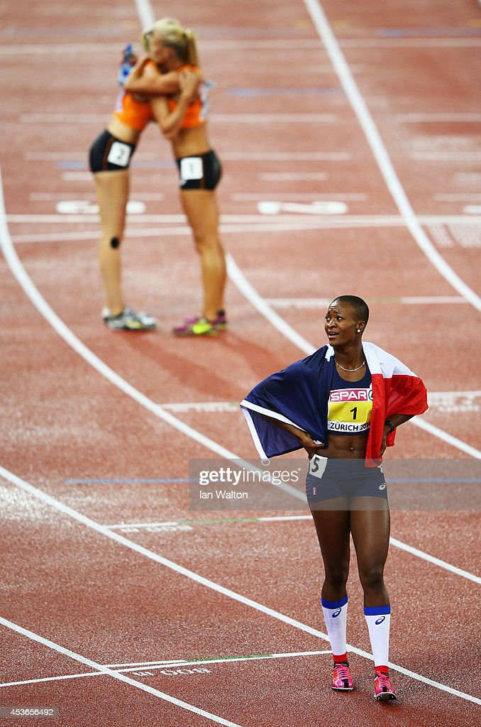 Antoinette Nana Djimou of France celebrates with the French national flag as she celebrates winning gold in the Women's Heptathlon during day four of the 22nd European Athletics Championships at Stadium Letzigrund on August 15, 2014 in Zurich, Switzerland.
